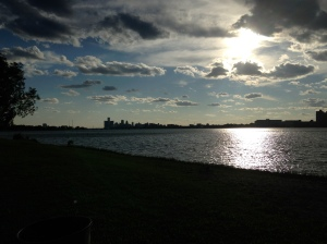 Belle Isle Beach with the sun setting by downtown Detroit.