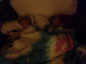 Little ladies sleeping in with my Care Bear bedspread.