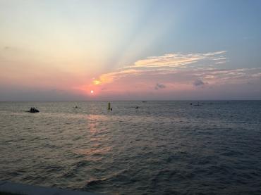 The sun rising before the swim start.